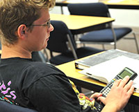 Student using a calculator in class.