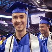 Student smiling on graduation day.