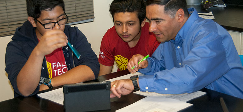Students working with an instructor.